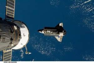 First space shuttle docking with ISS on this date in